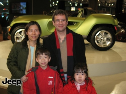 Picture of the family in front of the concept Jeep